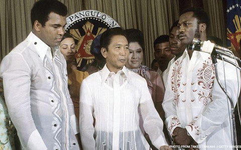 President Marcos stands with boxers Muhammad Ali (left) and Joe Frazier (right) in 1975 in for the Thrilla in Manila. All wear Pierre Cardin barongs