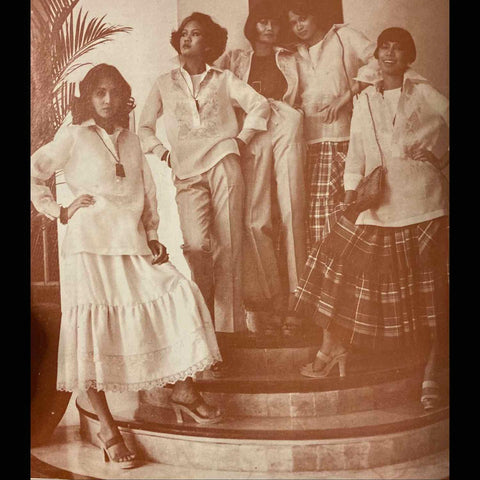 women models wear their Auggie Cordero barongs open and loose with colorful Ilocano plaid print long flowing skirts with pleats or relaxed long linen pants