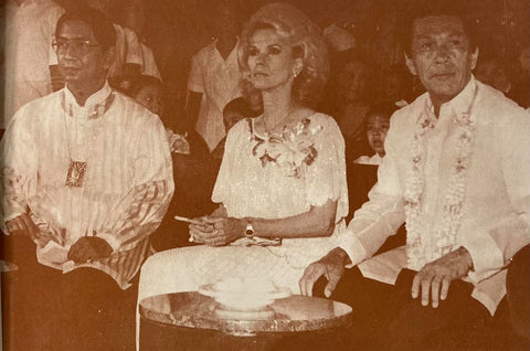 Ben Farrales (left in striped barong) sits with then Defense Minister Juan Ponce Enrile (right) and his wife Cristina (center)