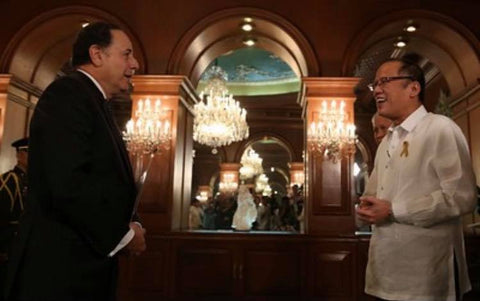 Aquino welcomes Chile's ambassador to the Philippines, Luis Lillo, to Malacañang Palace. He wears a barong