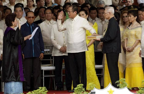 Aquino is sworn in at his inauguration at Quirino grandstand. He wears a Barong Tagalog