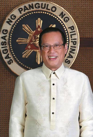 Aquino in his presidential portrait wears his signature Barong Tagalog.