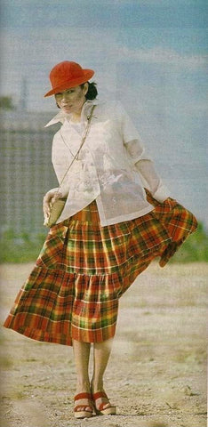 Bessie Badilla models an Auggie Cordero Barong Tagalog with a long flowing Ilocano plaid print skirt with pleats in Australia.