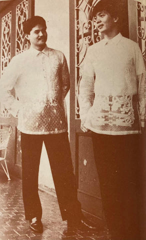 Gomez' brother-in-law (right) stands with one of his groomsmen at his wedding. Both are in Gang Gomez designed piña barongs with all over calado