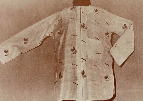 A camisa de chino made of translucent material with Philippine native scene imagery embroidered all over.