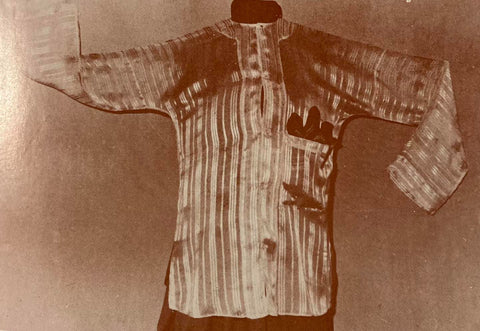 A camisa de chino made of translucent fabric with a vertical stripe pattern similar to Barong Tagalog designs.