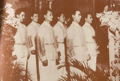 The groomsmen of the Carrion-Legarda wedding all stand together in their barongs. From de la Torre's book The Barong Tagalog.