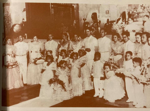 Entire wedding party of the Carrion-Legarda wedding in 1957. All males wear barongs, and all females wear ternos