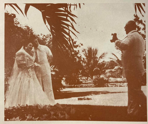 Bride and groom of the Carrion-Legarda wedding are photographed in 1957. Groom and photographer are in barongs