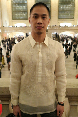 Chris M wearing a hand embroidered piña silk Barong Tagalog in Grand Central Terminal, New York City