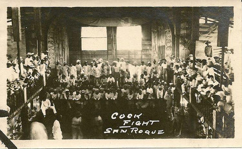 A multilevel cockfighting arena or cockpit in San Roque, Northern Samar early 1900's. The men wear white barongs or camisa de chino