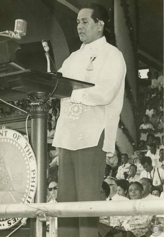 Macapagal addresses the audience in a Barong Tagalog. The photo is likely circa 1960's.