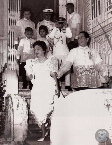 President Macapagal leaves his mother-in-law's residence with family. Males wear Barong Tagalog