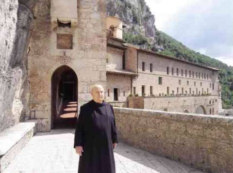 Sanna, known as Dom Giovanni, is presently a monk, and he stands in his black Benedictine habit at the monastery in Subiaco, Italy