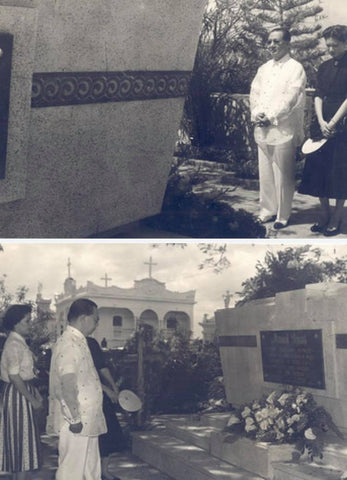 Quirino visits the tomb of President Manuel Roxas with his family. He wears a barong