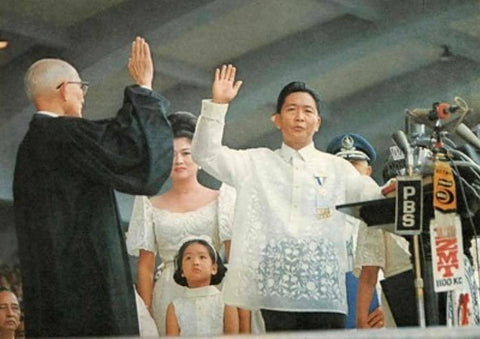 Marcos is sworn in at his second presidential inauguration on December 30, 1969. He wears a piña Barong Tagalog with all over embroidery.