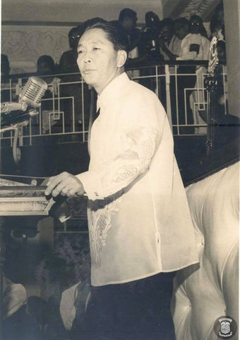 Marcos addresses the audience in his jusi (silk) Barong Tagalog probably in the mid to late 1960's.