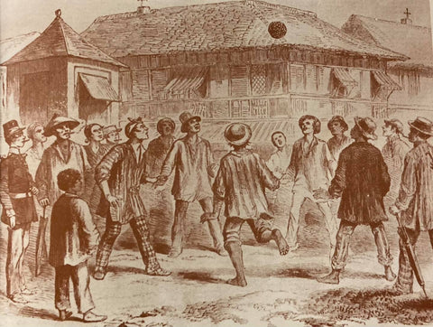 Illustration of a football game in a native residential neighborhood. Likely circa 18th/19th century. From de la Torre's book The Barong Tagalog. Most men wear loose barongs over trousers with European hats.