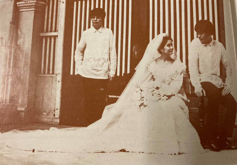 Gang Gomez (left) stands with his sister (center) and brother-in-law (right) at their wedding. Gomez and his brother-in-law wear tailored piña barongs with all over calado