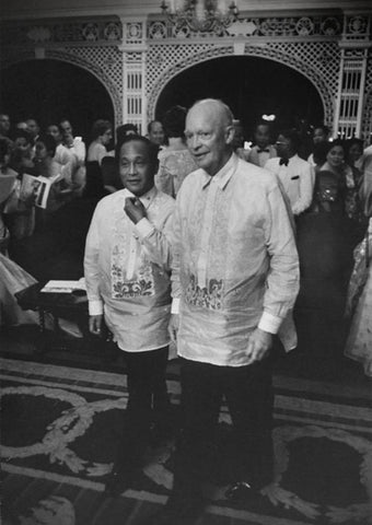 President Garcia walks with US President Eisenhower in Malacañang Palace during Eisenhower's visit to the Philippines in June 1960. Both presidents wear barongs
