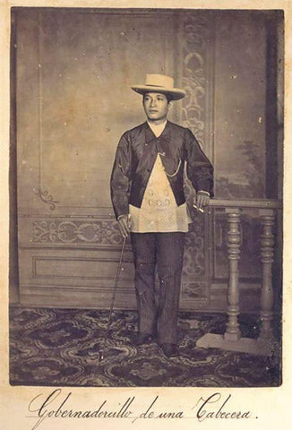 "Caption ""Gobernadorcillo de una Cabecera"". This man of the principalia class wears a Barong Tagalog underneath his short black jacket"