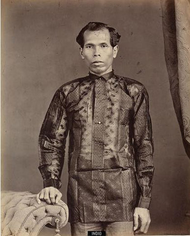 Photo of an unknown native Filipino man from the late 19th century. He wears a striped colored Barong Tagalog