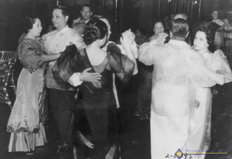 Manuel Roxas is the second from the left in a Barong Tagalog. He dances with his wife Trinidad Roxas y de Leon.