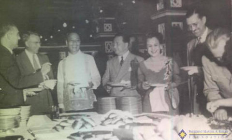 Manuel Roxas is wearing a Barong Tagalog during a buffet dinner with American dignitaries
