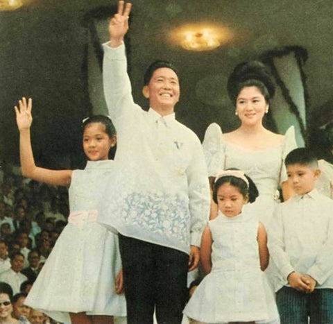 Marcos at his second presidential inauguration on December 30, 1969. He wears a piña barong and stands with his wife, Imelda, and three of his children.