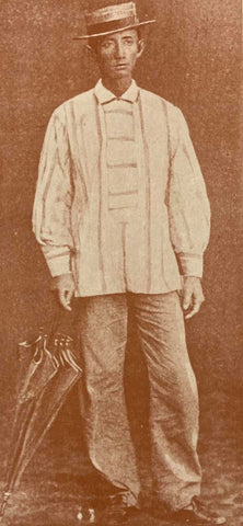 A middle to late 19th century photo of a mestizo merchant in his baro cerrada version of a barong probably made of abaca. From de la Torre's The Barong Tagalog.