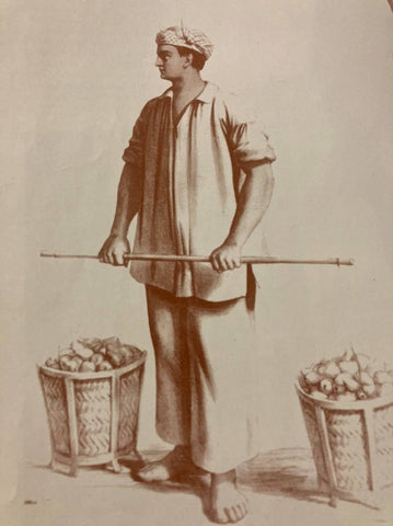 A fruit vendor wearing a white cotton barong with the sleeves rolled up while he works. He also wears loose white trousers and a putong on his head. Illustration from de la Torre's The Barong Tagalog.