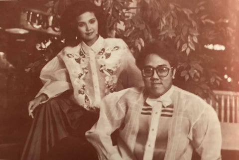 Pat Castillo sits with Danilo Franco, and both wear his mixed design barongs.