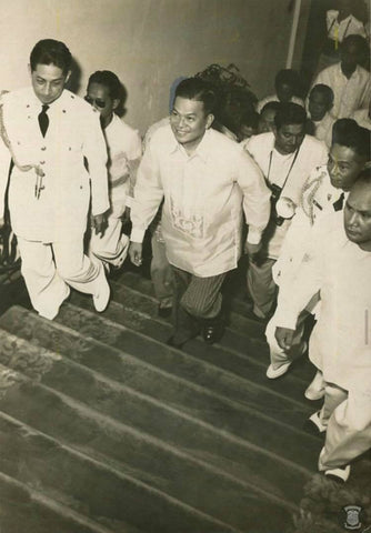 Magsaysay walks up the steps of Malacañang Palace in his barong on his Inauguration Day