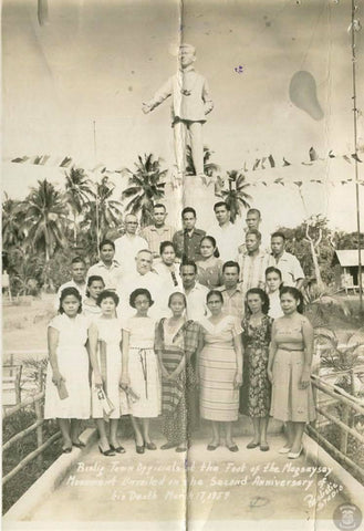 Bislig Town Officials at the foot of the Magsaysay Monument where Magsaysay is depicted in a barong