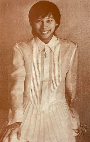 Renee Salud in a long barong with embroidered vertical lines and bottom pleats.