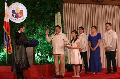 Duterte is sworn in as president at his inauguration on June 30, 2016. The top he wears is not a barong