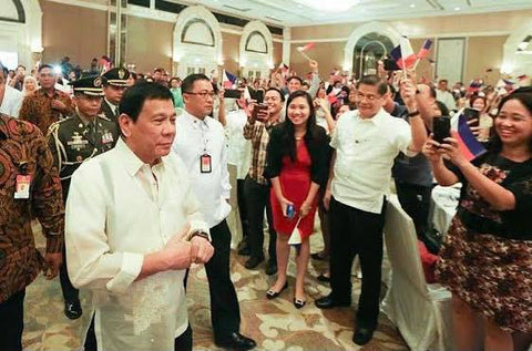 Duterte meets with Filipinos in Jakarta, Indonesia on September 9, 2016. He wears a jusi Barong Tagalog
