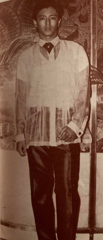 Model wears a de Leon Barong Tagalog with a windowpane pattern and front embroidery.