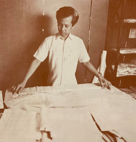 Turing Calumba, master cutter of Tesoro's, at work in a full button down polo barong