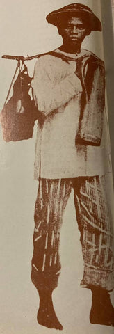 Photo of native male vendor wearing a camisa de chino, striped salawal and a salakot (helmet-like native hat) on his head. Likely from 19th century. From de la Torre's The Barong Tagalog