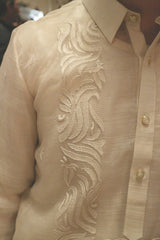 Right shoulder and upper chest portion of hand embroidered piña silk Blase Barong Tagalog with button placket, right side of collar and right sleeve showing
