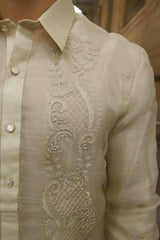Closer look at the left shoulder and upper chest portion of the hand embroidered piña silk Chris M Barong Tagalog. Also shown is the button plackets and left sleeve
