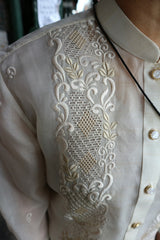 Product shot of the right shoulder and upper chest area of the hand embroidered jusi Chrissi Barong Tagalog