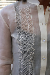 Product picture of the right shoulder and upper chest portion of the hand embroidered cocoon Coley Barong Tagalog