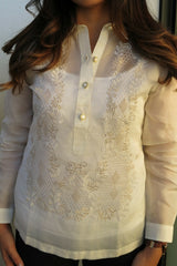 Product shot of the hand embroidered jusi Krizia Barong Tagalog. Krizia's hair covers parts of the top of the barong