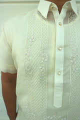 Closeup photo of the calado hand embroidery on the right side of the cocoon Marc Barong Tagalog. The collar and center button placket can be seen.