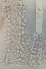 Closeup of the bottom left corner of the calado hand embroidery of the piña silk Michelle Barong Tagalog