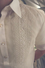Closeup photo of the calado hand embroidery on the upper right corner of the cocoon Tiger Barong Tagalog. Tiger wears a chamisa de chino underneath his barong,