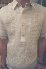 Product photo of the short sleeve hand embroidered cocoon Tiger Barong Tagalog. Tiger wears a chamisa de chino underneath his barong, a watch on his left wrist and a brown beaded bracelet on his right wrist