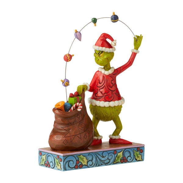 Grinch Juggling Gifts Into Bag Figurine